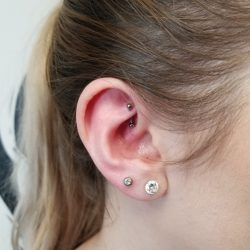 Rook Piercing with a 16 gauge internally threaded curved stainless steel barbell.