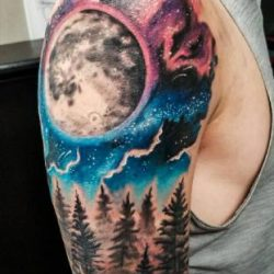 Black and grey forest and moon custom tattoo in black and grey with a full color galaxy background.