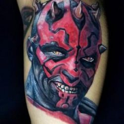 Star Wars Dark Side tattoo of Darth Maul portrait. Full color tattoo on the inner arm.