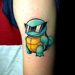 Full color tattoo of the Pokémon, Squirtle wearing sunglasses. Gotta catch 'em all!