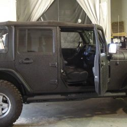 Jeep with black LINE-X coating