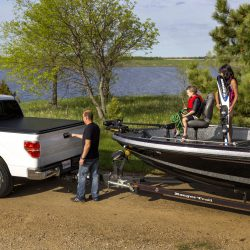 truck with tonneau cover hauling boat