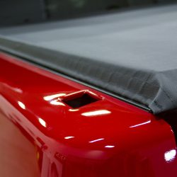 soft tonneau cover on a red truck