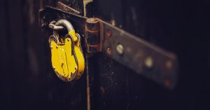 Yellow lock on a dark brown door