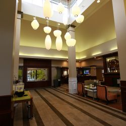 Renovated Hotel Lobby With Chandelier - Sage Construction