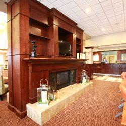 Custom Finish Carpentry on Hotel Lobby Fireplace