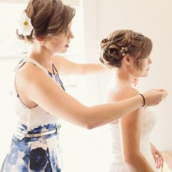 two women getting ready for a wedding