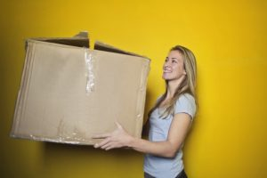 3 Essential Moving Tips for Seniors - Woman with Moving Box