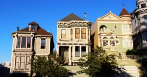 Old-fashioned Victorian-style houses in a row.