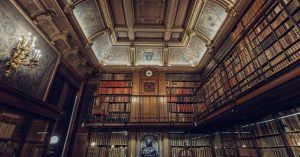 Beautiful old-fashioned library with many books and fancy architecture.