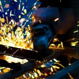 A manufacturing process with sparks flying.