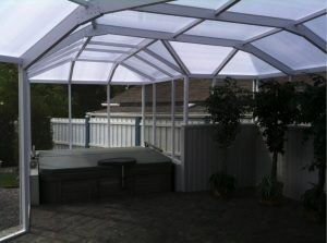 Image of a polycarbonate roof over a hot tub