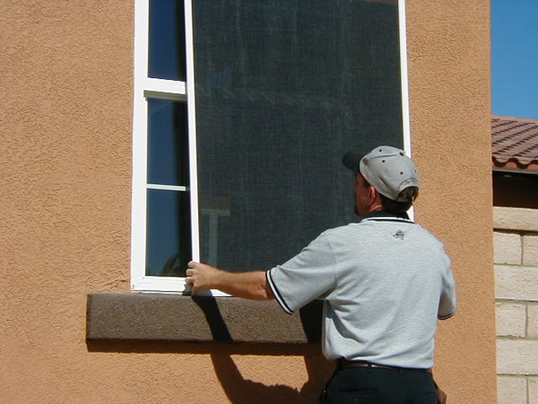 Image of a man installing a sun blocker.