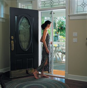 Image of a woman opening a door