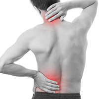 man experiencing neck and back pain