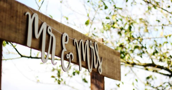 an image of a wooden sign with the words Mr. and Mrs. on it