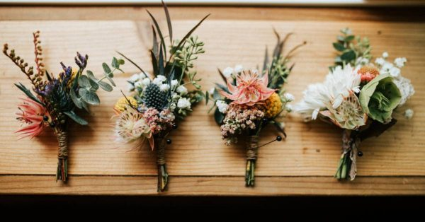 an image of four bouquets of flowers on a wooden background