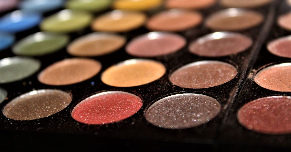 A close up of a wide variety of eye shadow palettes. Photo by Siora Photography on Unsplash.