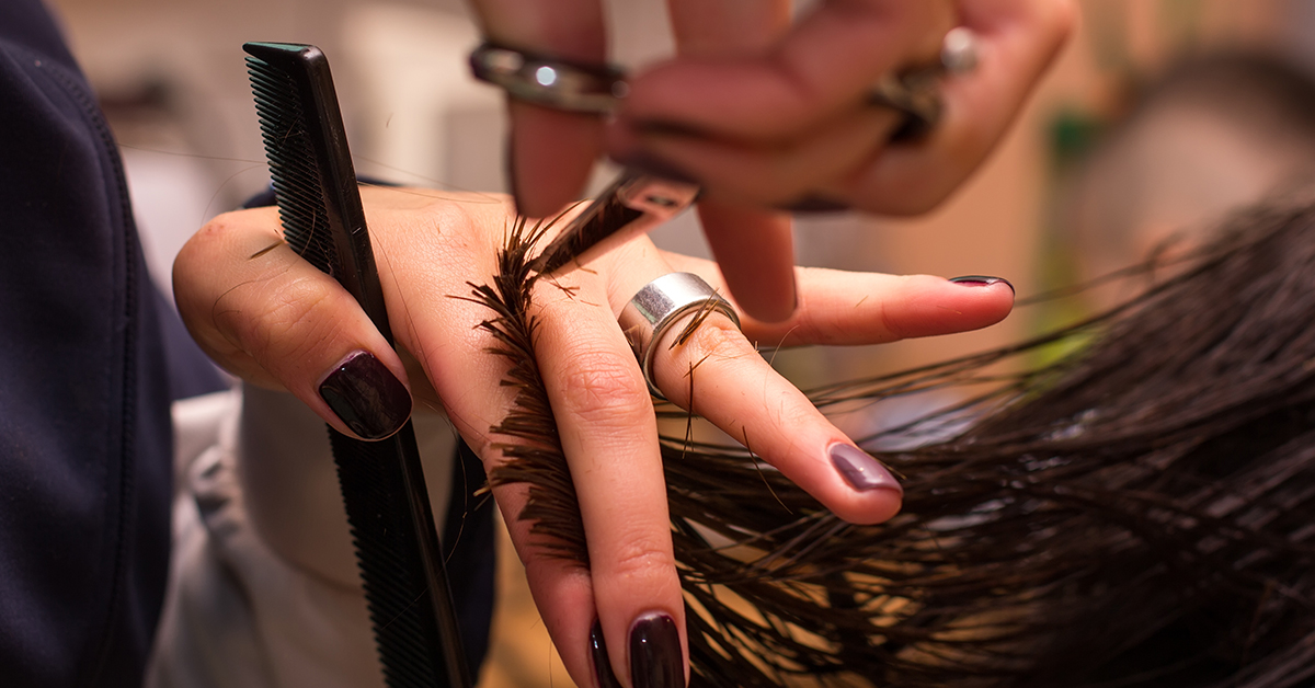 close up of hair stylists hands at work