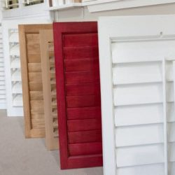An image of a row of shutters on display in Shutters And More's Los Angeles showroom.