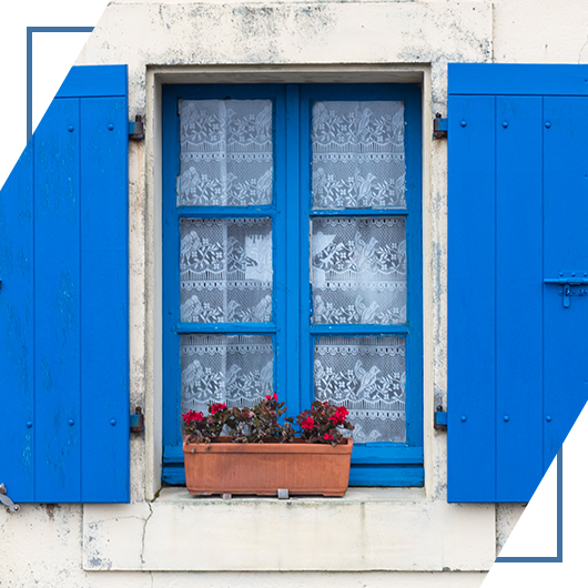 An image of some eye-catching blue exterior shutters designed by Shutters And More.