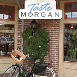 The custom business sign for Taste Morgan