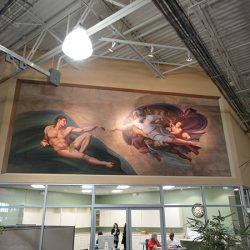 A beautiful wall mural of the Creation of Adam