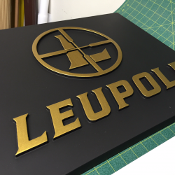Making of custom sign with gold leafing in production