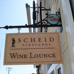 Admiring our custom winery sign for Scheid Vineyards