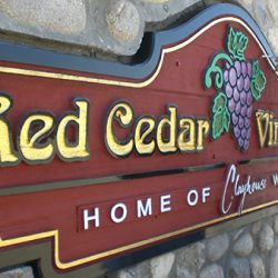 Putting the finishing touches on a custom winery sign for Red Cedar Vineyards
