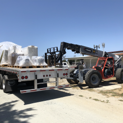 Unloading new equipment at our Monterey County sign company