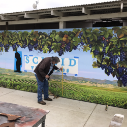Measuring a custom vineyard sign to make sure it's perfect