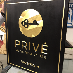 Black and gold custom signage for Prive real estate