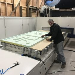 Cutting out a custom sign from green foam