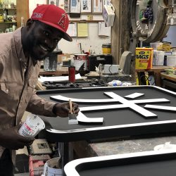 Sign painting for a custom sign