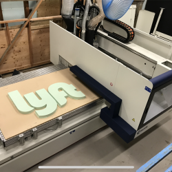 Our machine making a custom business sign for Lyft