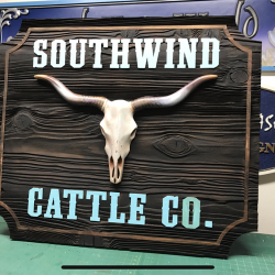 Custom wood signage of a longhorn skull for Southwind Cattle Co.