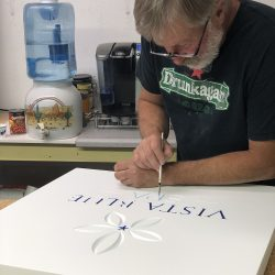 Painting custom business signage for Vista Blue Spa