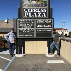 The custom business sign for Cypress Plaza