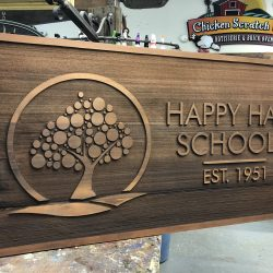 A custom wood business sign for Happy Hall Schools