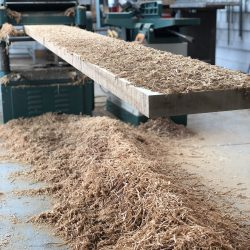 Wood shavings from custom wood signage
