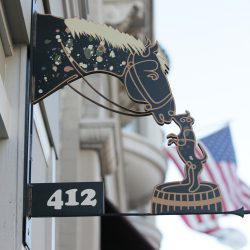 Custom metal signage featuring a horse and dog