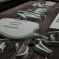 Foam letters and shapes on wood signage