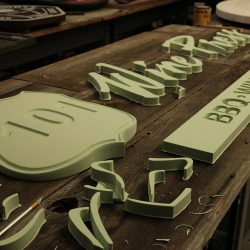 Custom signage made out of green foam