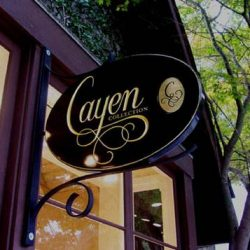 Black and gold custom business sign for Cayen Collection