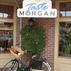 The custom business sign for Taste Morgan