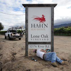 Installing the custom vineyard sign for Lone Oak Vineyard