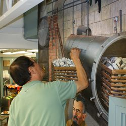 Painting machinery on a custom wall mural