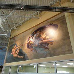 A custom wall mural of the Creation of Adam