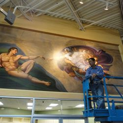 Our skilled artist working on this custom wall mural